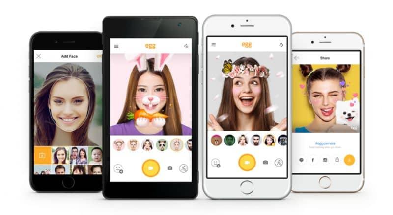 personas en la pantalla del móvil Snapchat con filtros de máscara