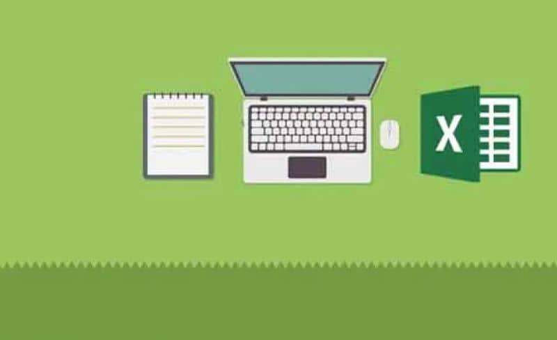 Laptop y excel laptop con fondo verde