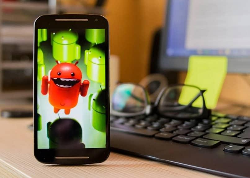 icono de teléfono móvil android diente