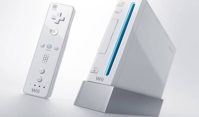 consola blanca y controlador wii