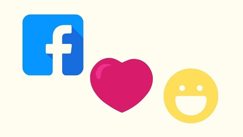 Facebook logo corazón emoji y emoji de cara feliz amarilla