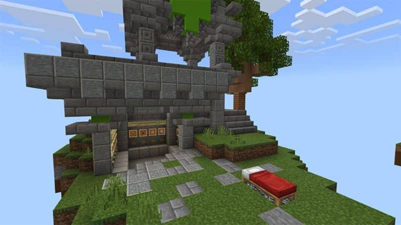 cama roja y casa en la colina en minecraft